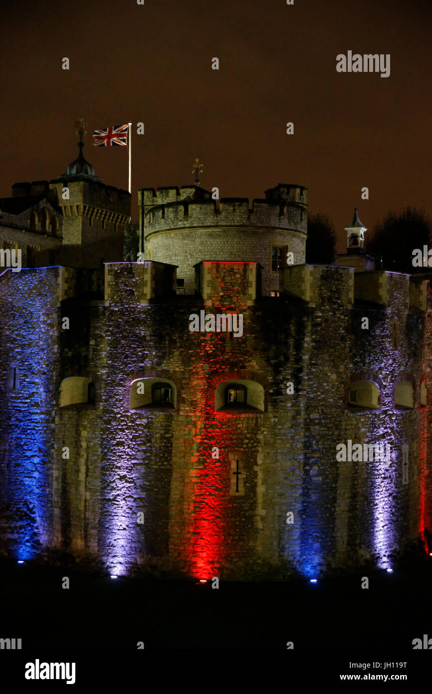 London tower illuminated with the colors of the French flag after the nov.13,2015 terrorist attacks in Paris. United - Stock Image