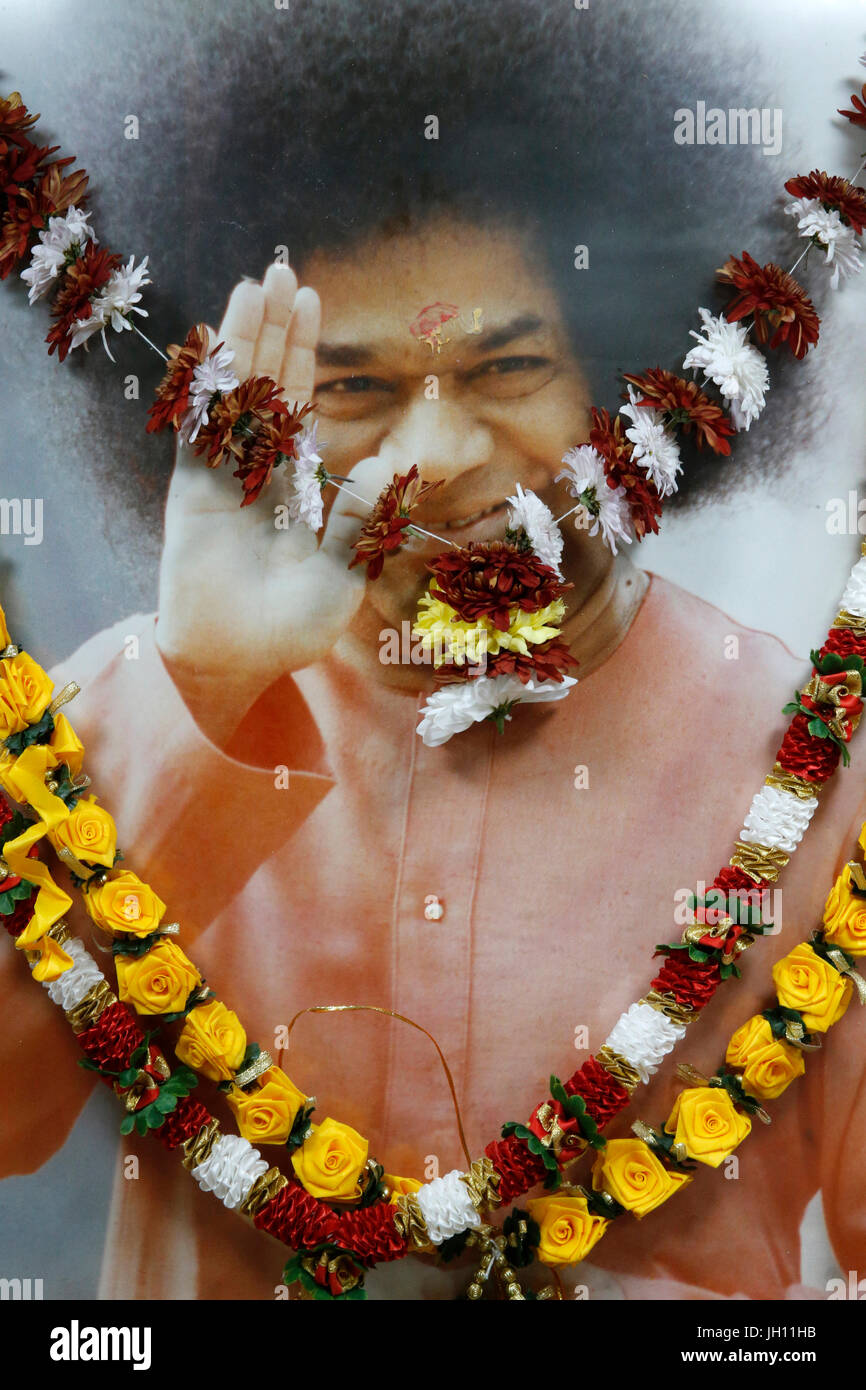 Shree Ram Mandir, Leicester. Garlanded Sai Baba picture. United kingdom. - Stock Image