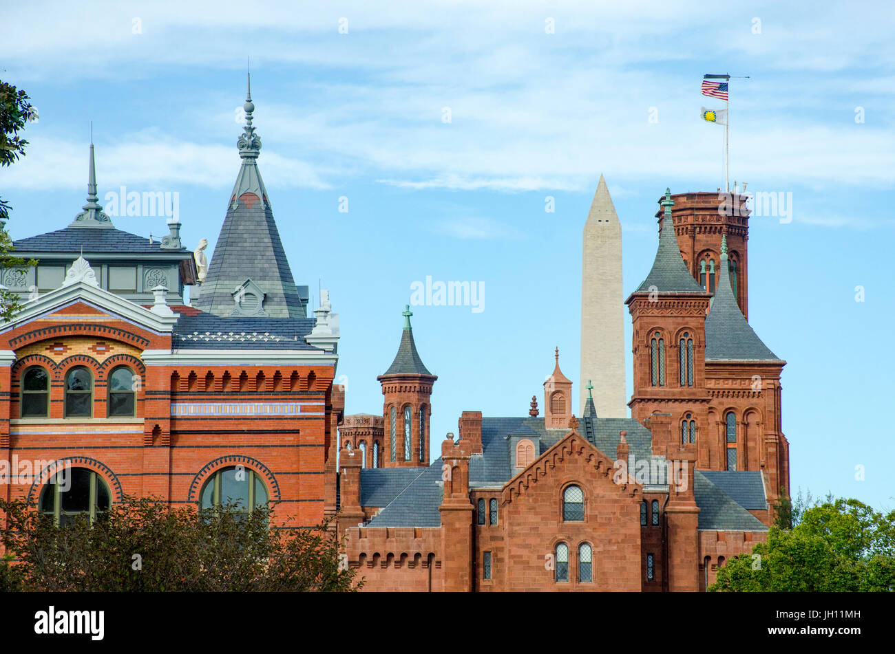 Spires from the Smithsonian Institution's Arts & Industries building and the Smithsonian Castle are - Stock Image
