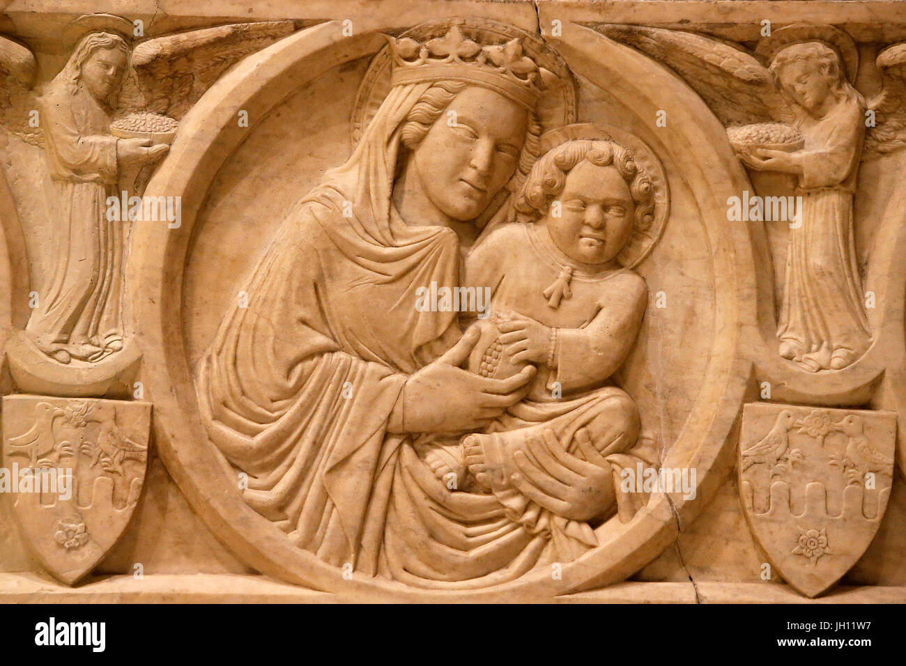 The Victoria and Albert Museum. Relief from a sarcophagus. 1350-75. Italy, Naples. Detail : Virgin and child. United - Stock Image