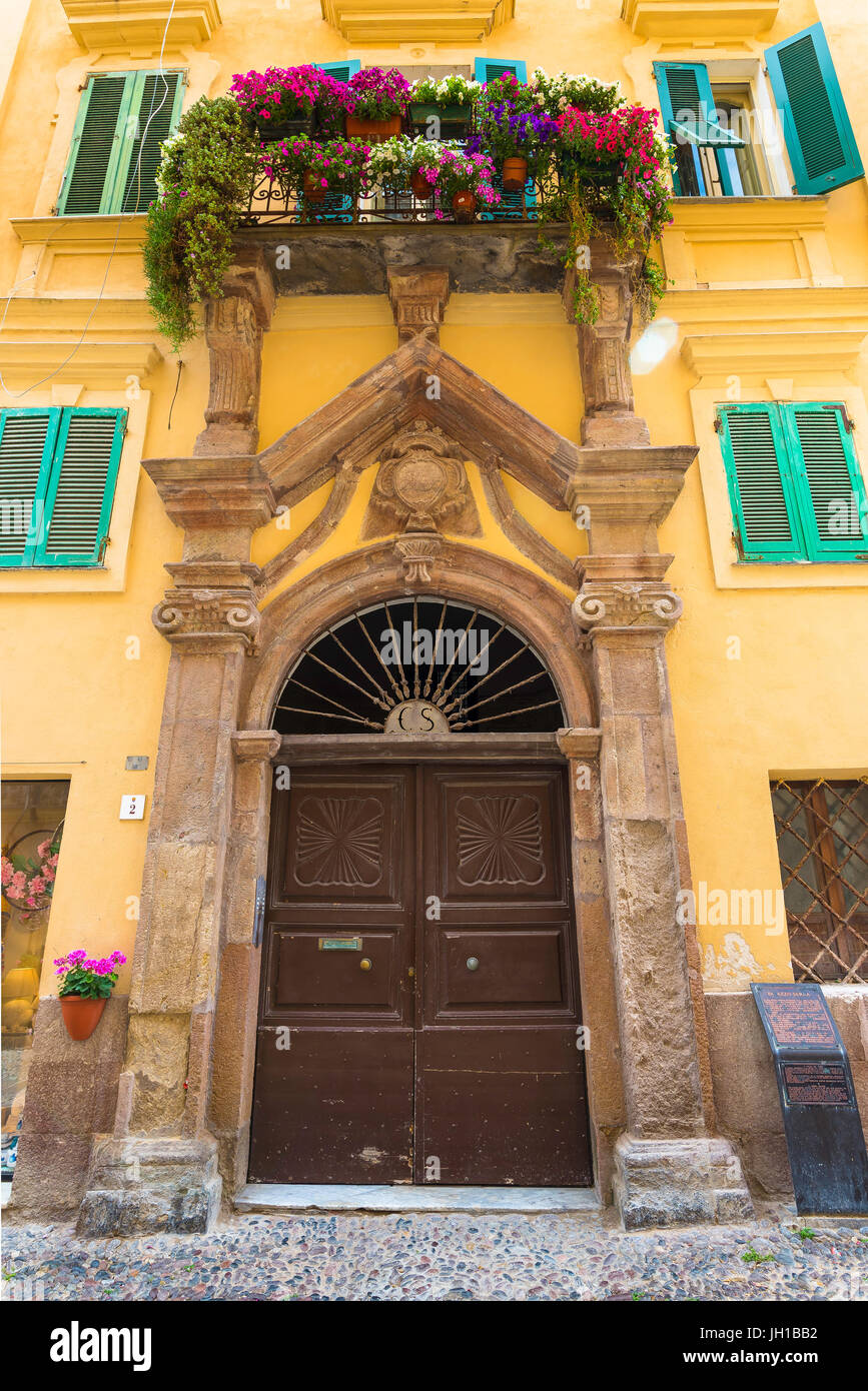 Alghero Sardinia, entrance to the Palazzo Serra in the Piazza Civica, in the old town quarter of Alghero, Sardinia. - Stock Image