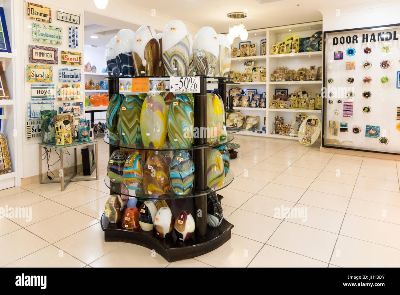 Glass products for sale inside the Mdina glass blowing factory at the Ta'Qali Craft village Malta - Stock Image