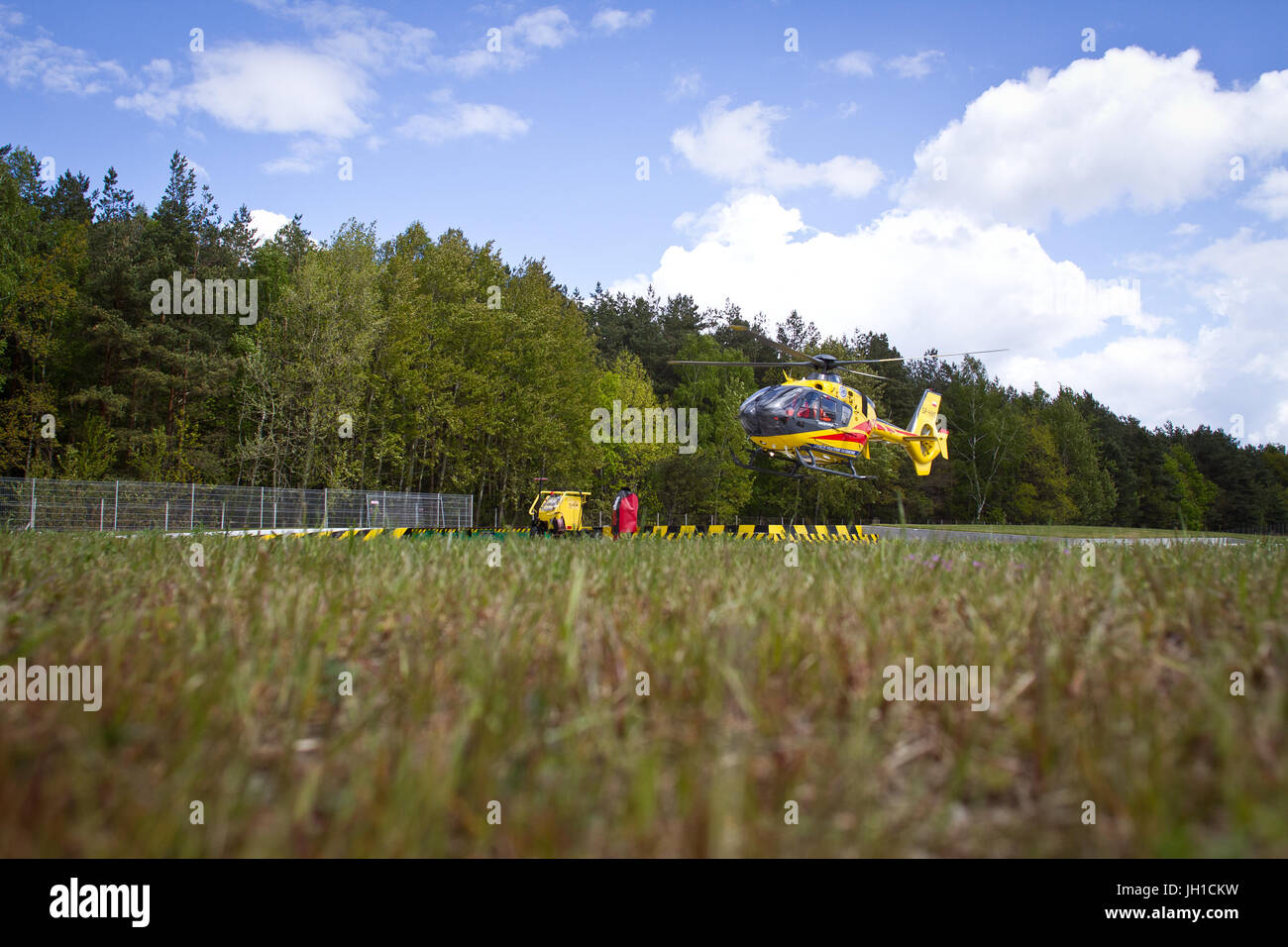 Polish Helicopter Emergency Medical Service (HEMS) Eurocopter 135 take off to action. Stock Photo