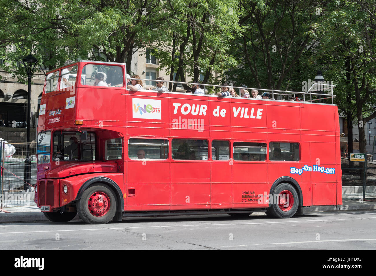 Montreal, CA - 9 July 2017: British style Double-decker tour bus 'Tour de ville' in Vieux-Montreal - Stock Image
