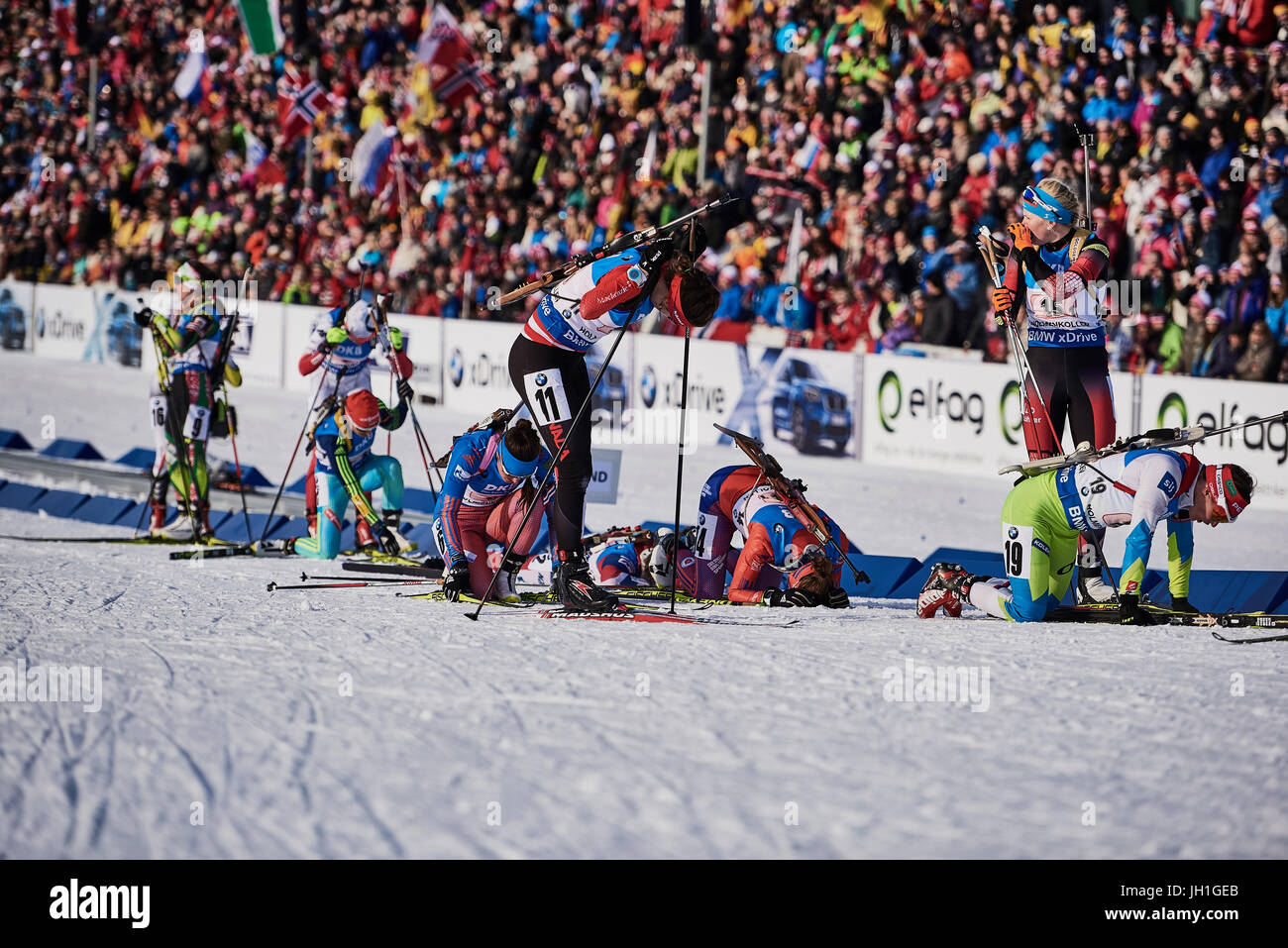Teams from the Woman's relay exhausted after the hand over at the IBU Biathlon World Championships Oslo Norway - Stock Image