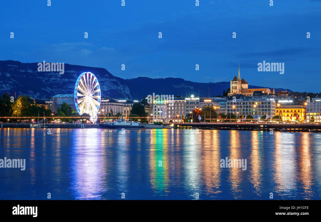 View over the Rhone and the Old Town with the St. Peter's Cathedral and a ferris wheel at the shore. Geneva, - Stock Image
