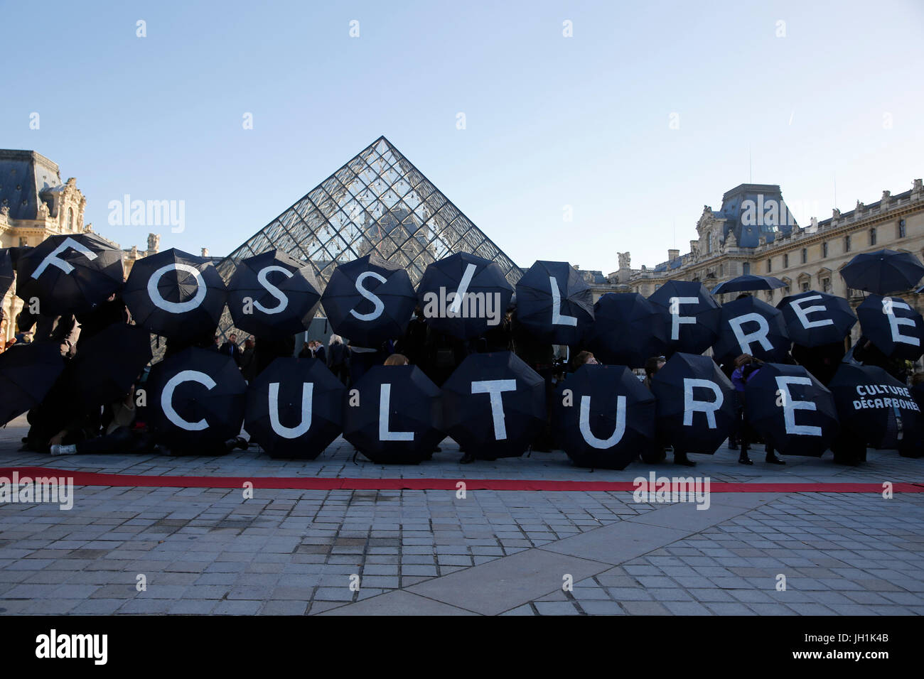 Demonstration outside the Louvre museum during the COP 21 climate summit. France. - Stock Image