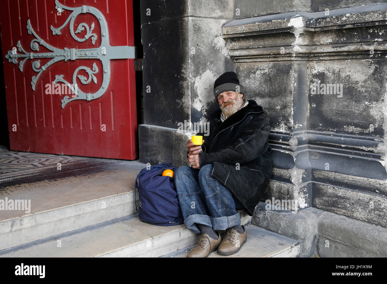 Beggar outside Marseille cathedral. France. - Stock Image