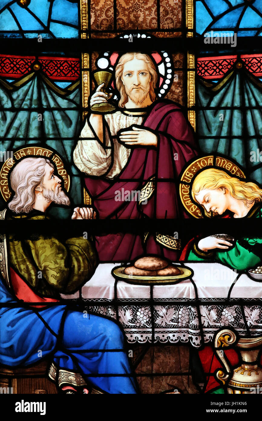 Moulins cathedral. Stained glass window. The Last Supper is the final meal that Jesus shared with his Apostles in - Stock Image