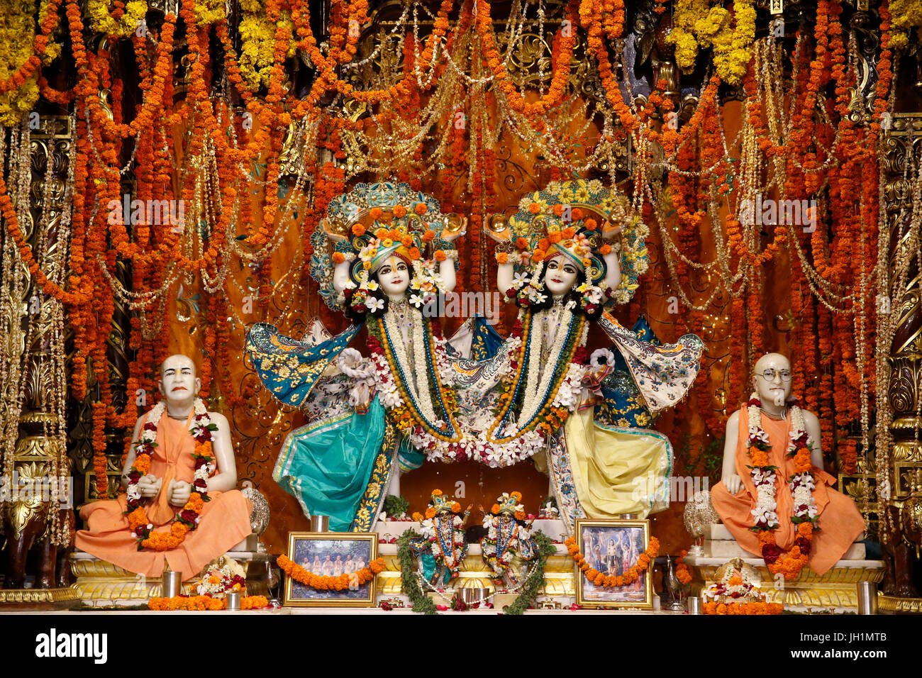 Left altar of Krishna-Balaram temple, Vrindavan. Murthis of Gaura-Nitai, Chaitanya Mahaprabhu with Nityananda, and - Stock Image