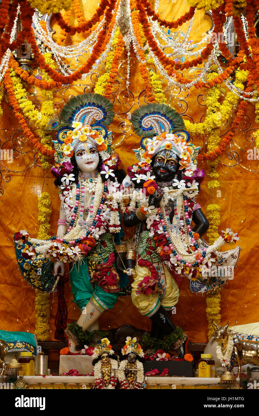 Balaram and Krishna murthis in the central alter of the Krishna-Balaram temple, Vrindavan. India. - Stock Image