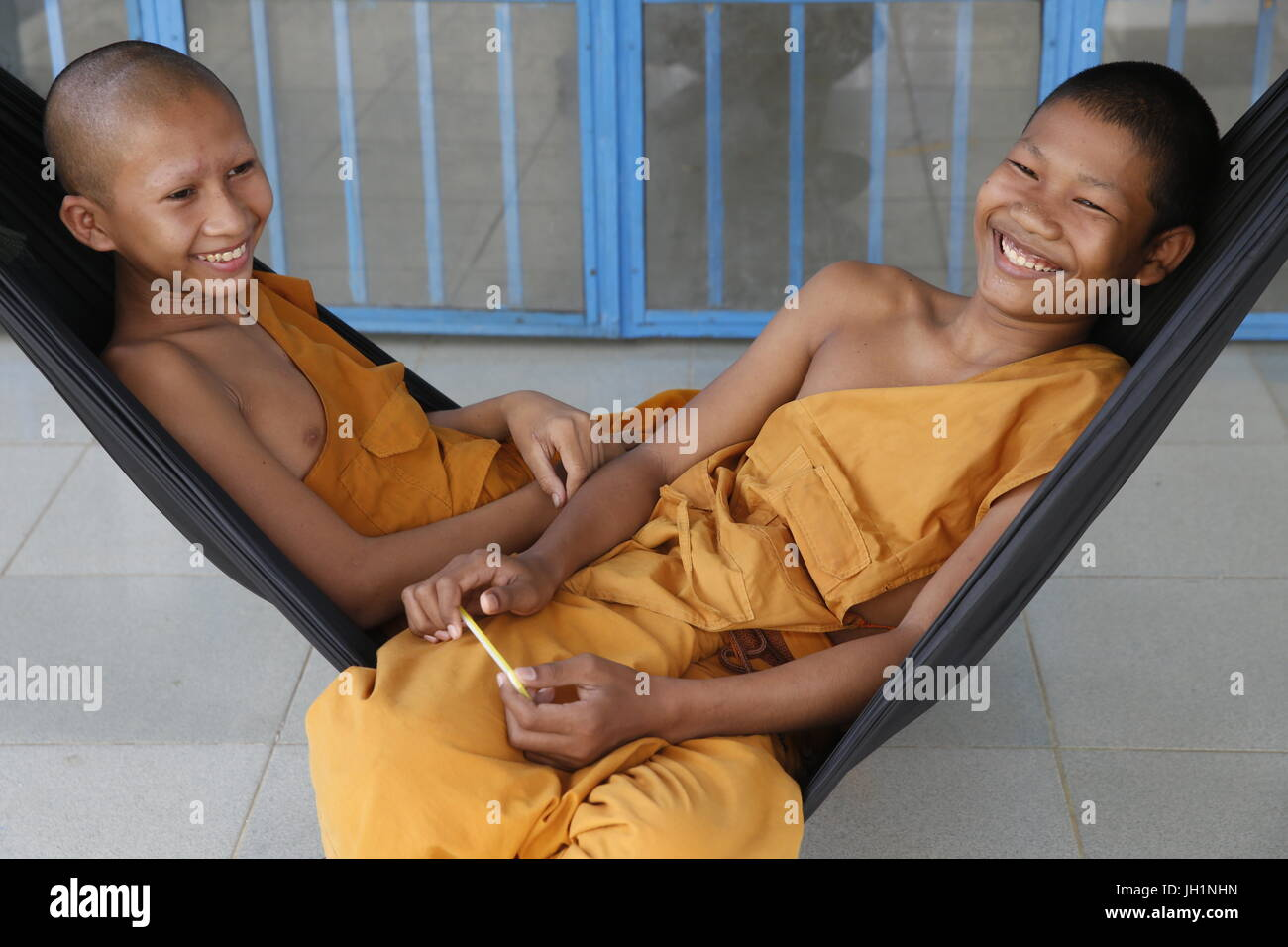Novice monks in hammocks. Cambodia. - Stock Image