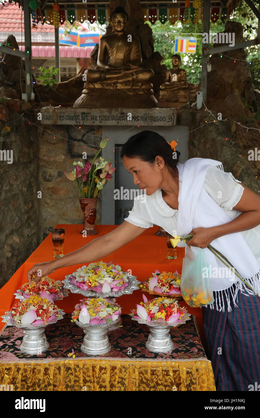 Buddhist lay woman preparing a ceremony. Cambodia. - Stock Image