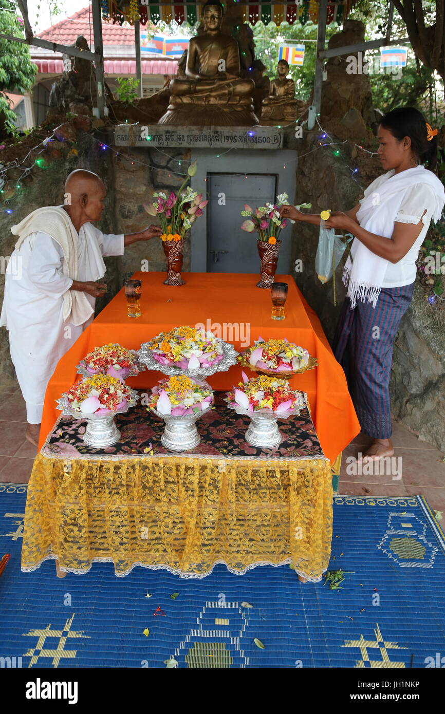 Buddhist nun and lay woman preparing a ceremony. Cambodia. - Stock Image