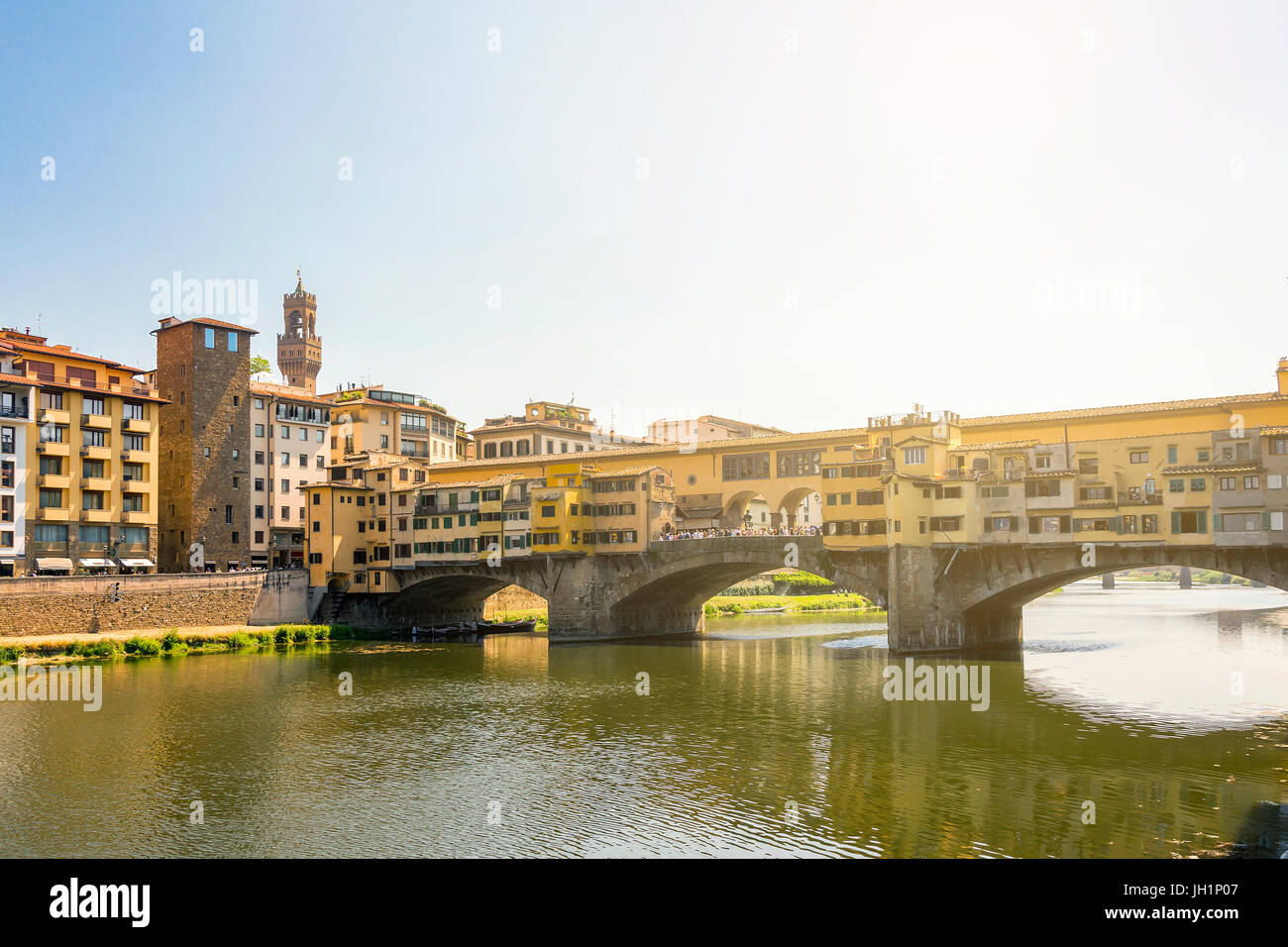 Medieval stone bridge Ponte Vecchio over the Arno River in Florence, Tuscany, Italy. Florence is a popular tourist - Stock Image