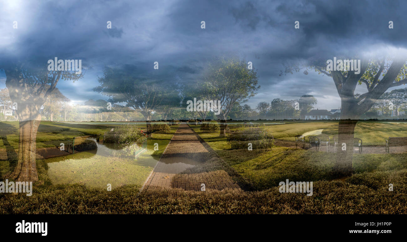 Contemporary public park superimposed on a primitive landscape to illustrate 'return to nature' and climate - Stock Image