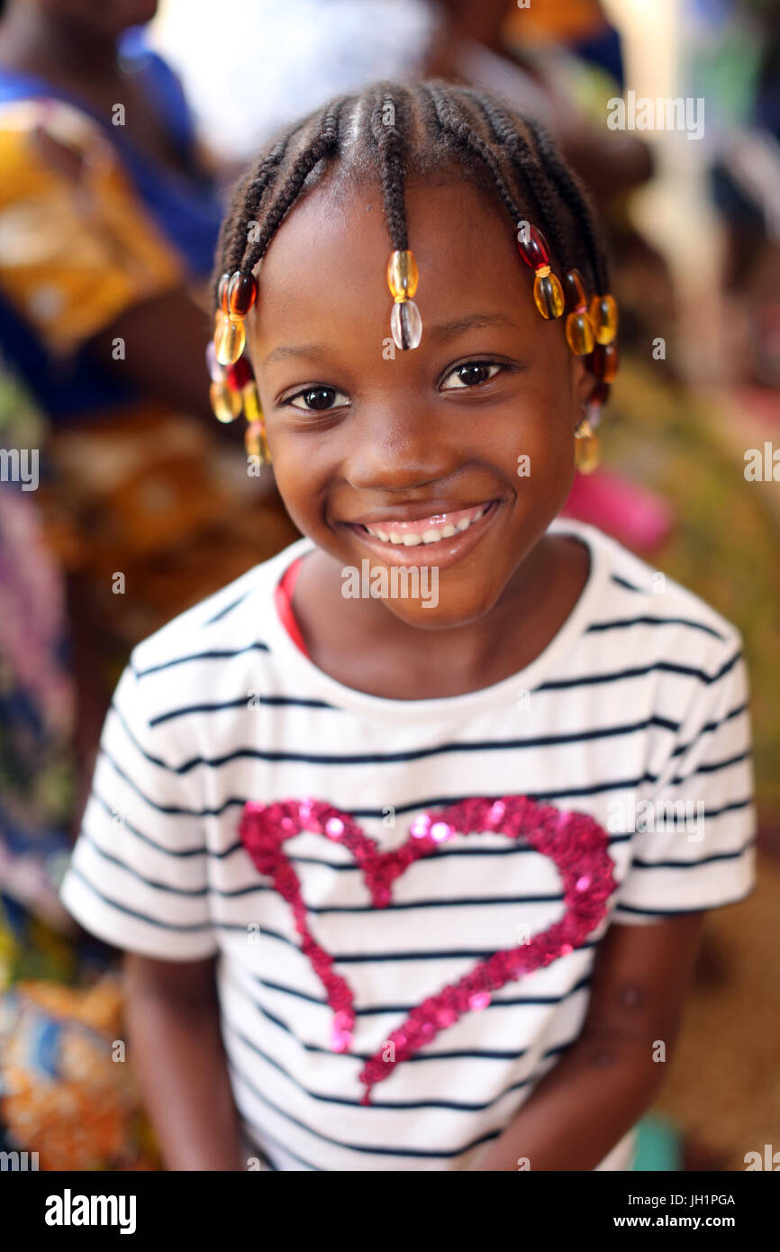 African girl wearing braids. Togo. - Stock Image