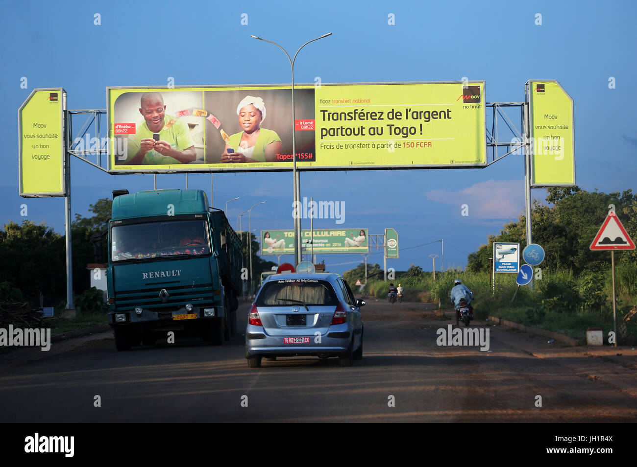 African road. Money transfer signs.  Togo. - Stock Image