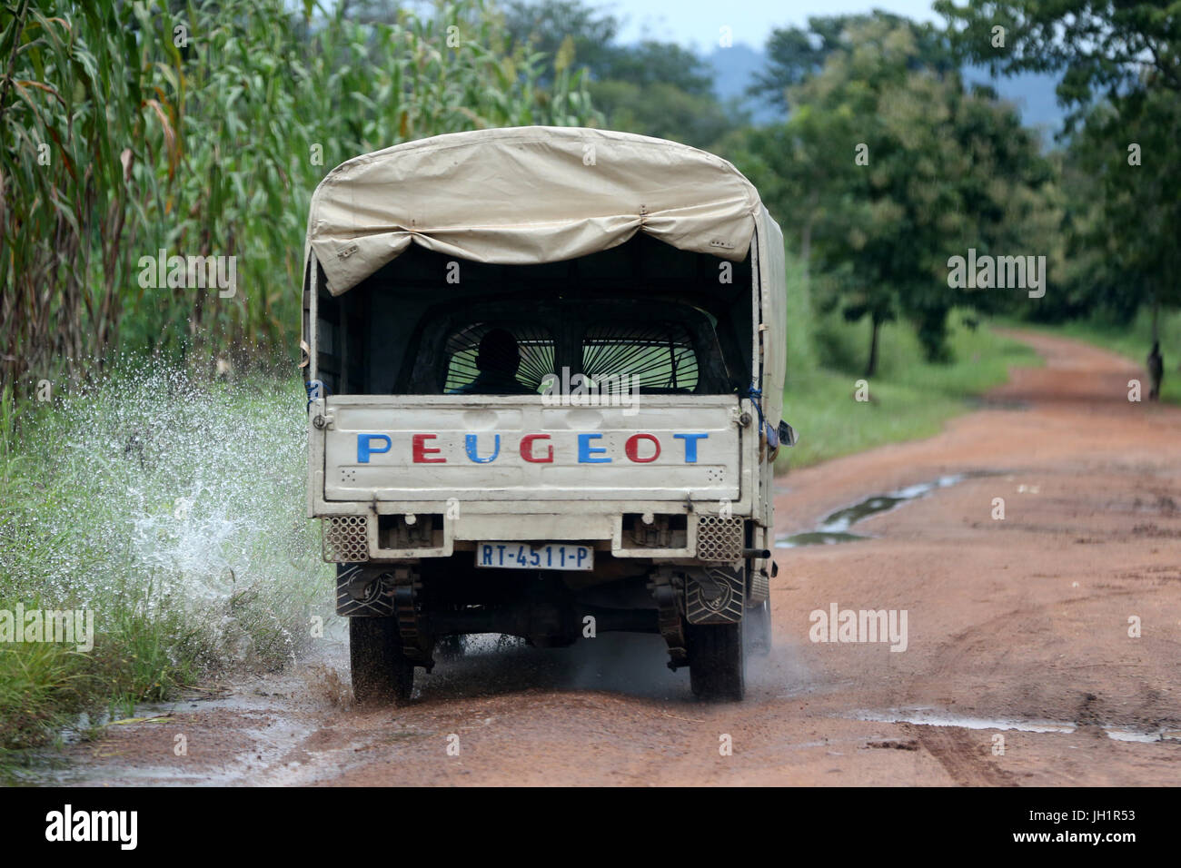 African road. Peugeot pick-up.  Togo. - Stock Image