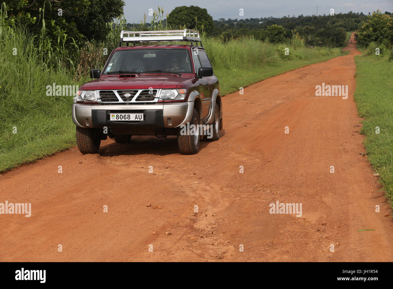African road. Nissan 4 wheel drive.  Togo. - Stock Image