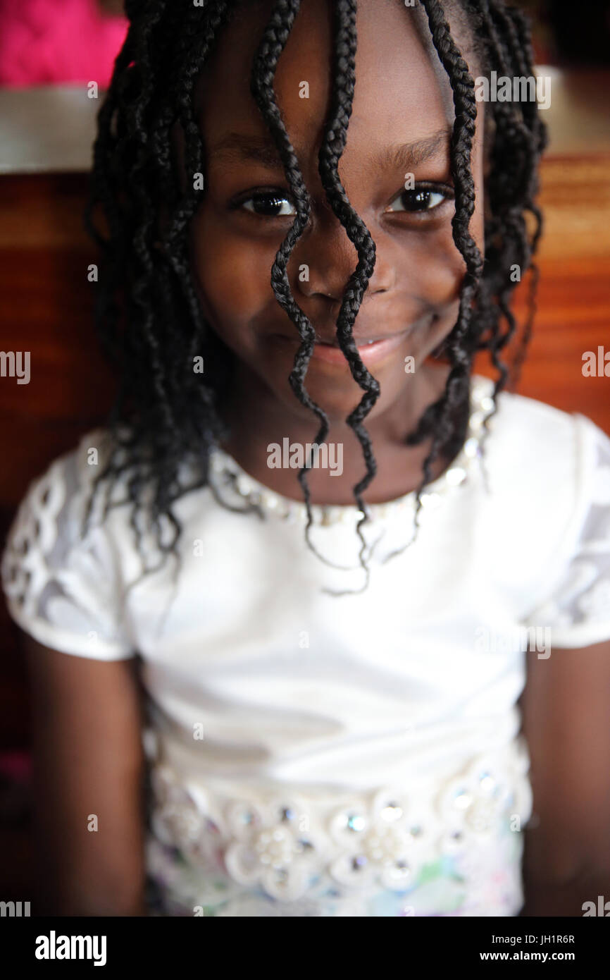 African girl wearing braids. Lome. Togo. - Stock Image