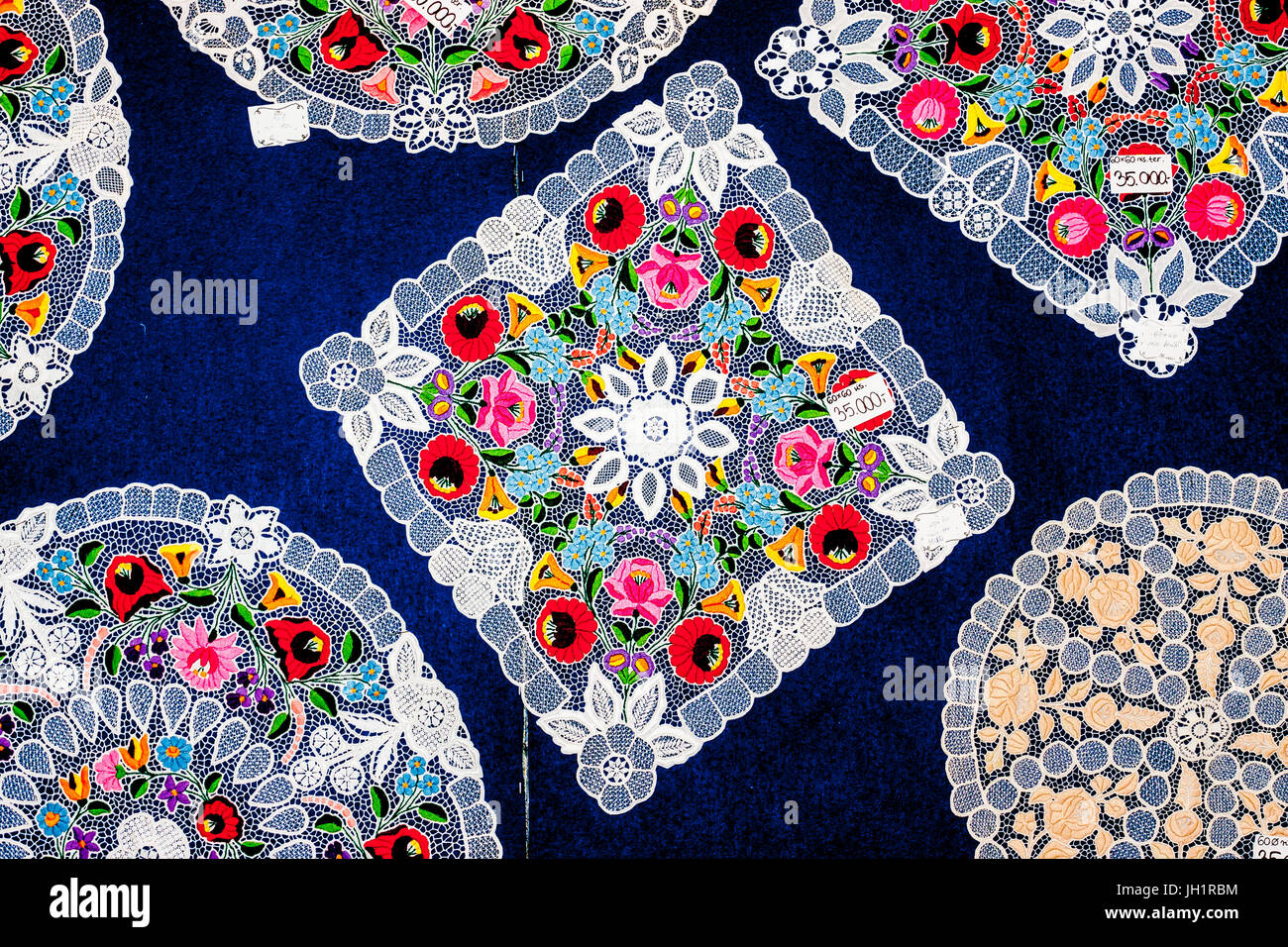 Handmade richeliau embrordered lace tablecloths in Kalocsa, a town in Bács-Kiskun county, Hungary - Stock Image