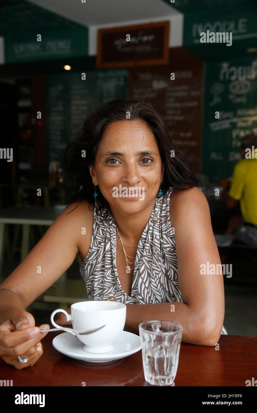 40-year-old woman in a cafŽ. Thailand. - Stock Image