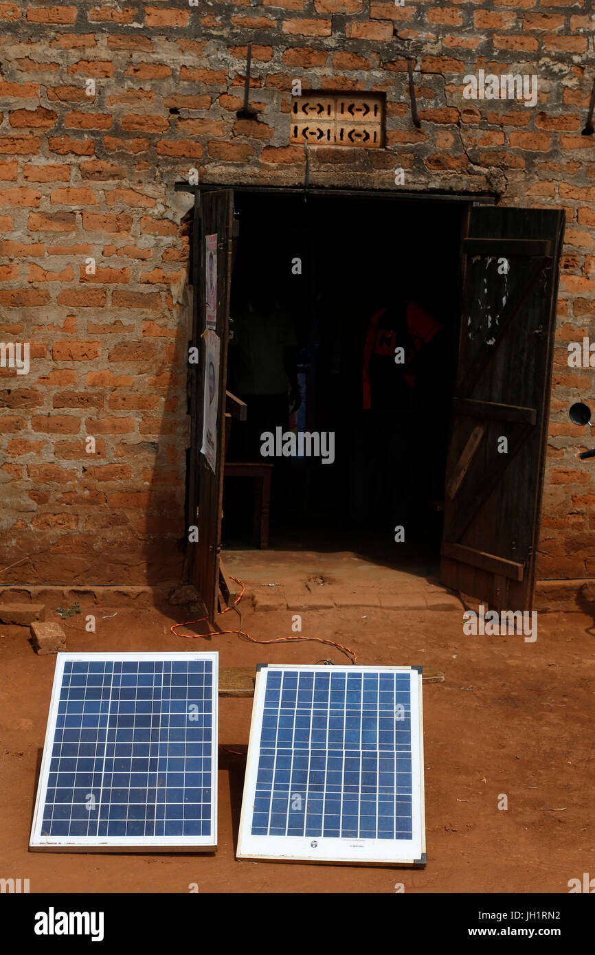 Solar panels outside a bar financed by a loan from Kolping. Uganda. - Stock Image