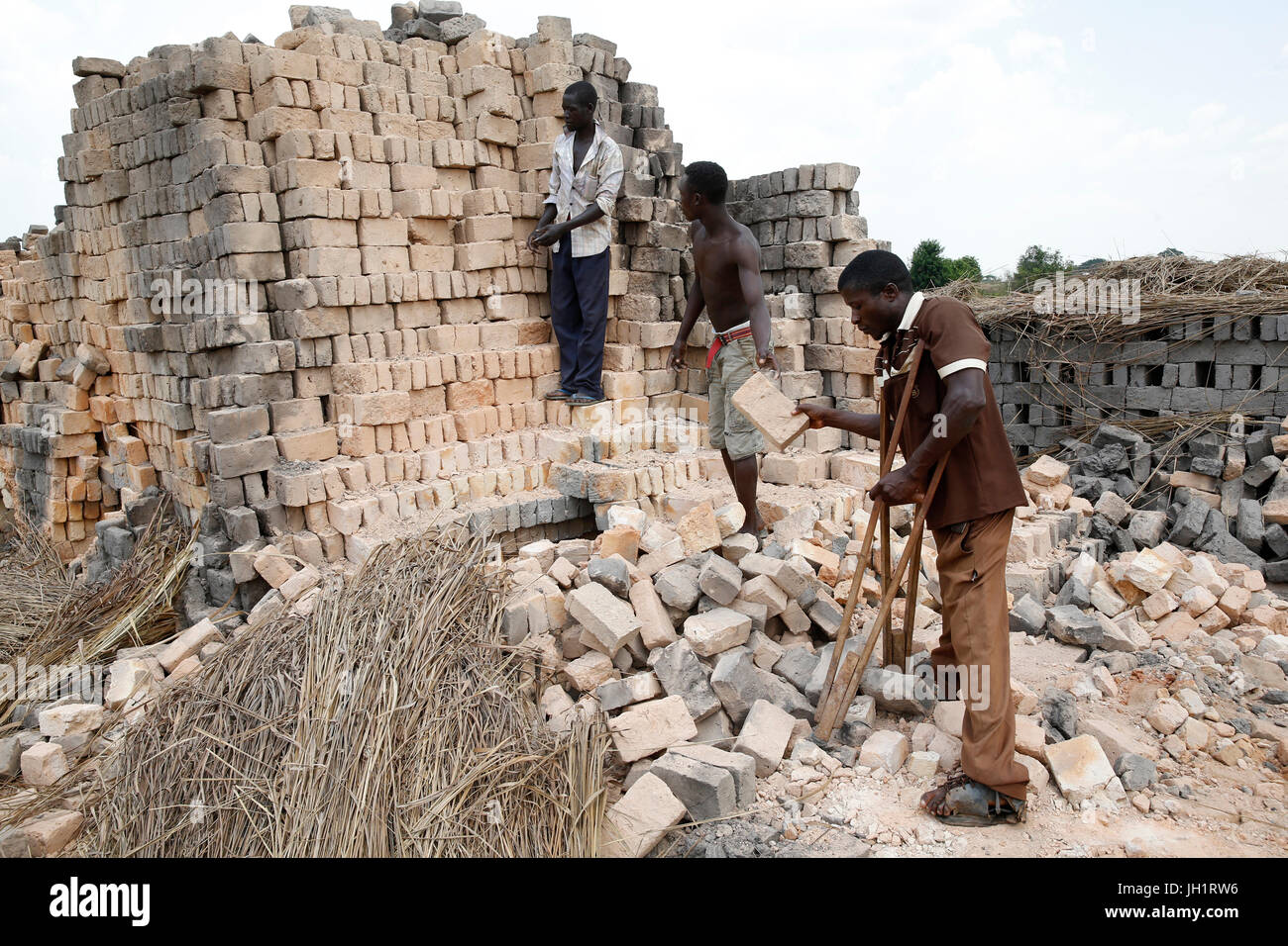 Charles Barikrungi received 4 loans from ENCOT Microfinance. He employs 20 workers on his brick factory. Uganda. - Stock Image