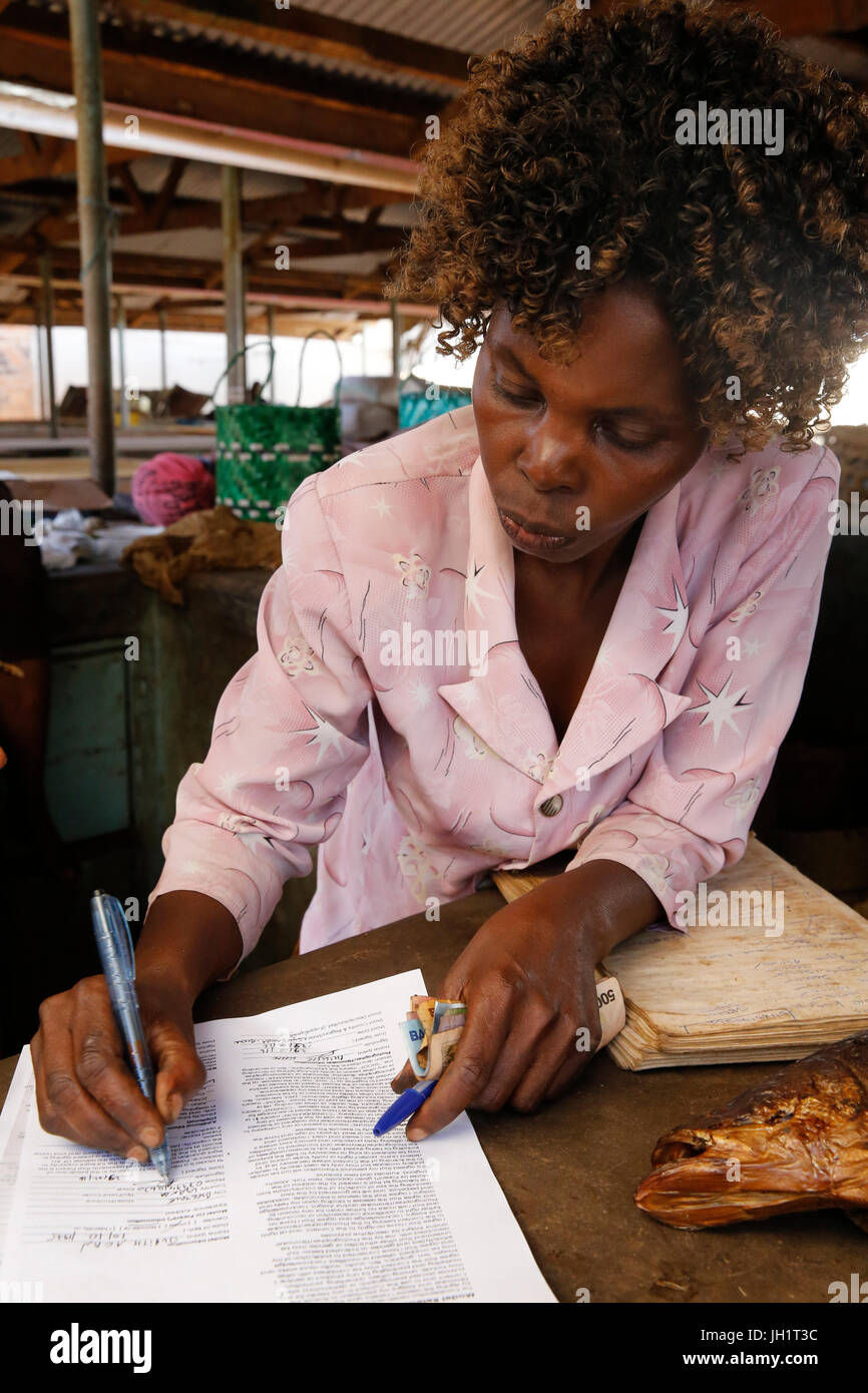 Uganda Microfinance Foundation client Judith Acan, who received 5 loans from UMF to produce and sell fish. Uganda. - Stock Image
