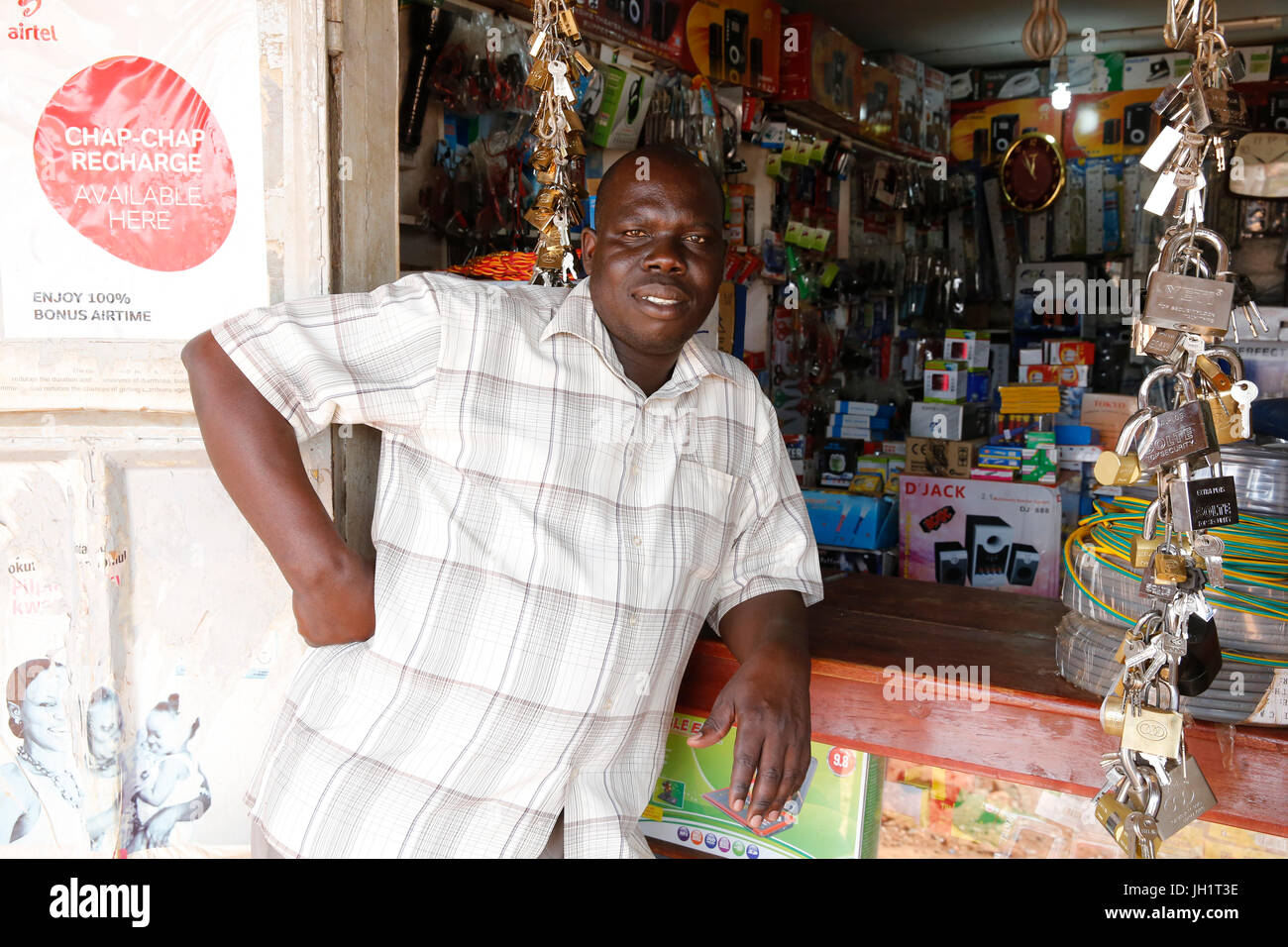 Jackson Oloya runs a shop in Bweyale. He is currently servicing his 4th loan from UMF microfinance (30,000.000 UGS). - Stock Image