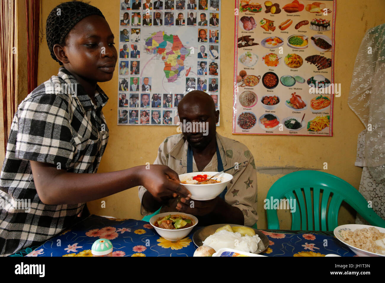 Small restaurant at Bweyale market run by Evelyn Akullo, who received a 1,500.000 UGS from Uganda Microcredit Foundation. - Stock Image