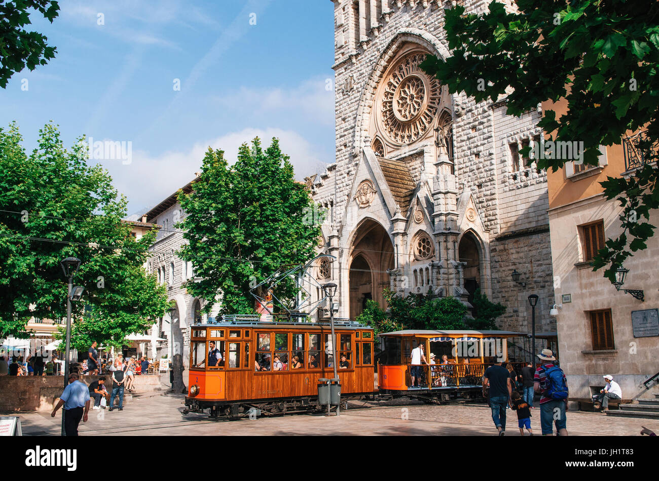Port de Soller, Mallorca, Spain - May 26, 2016: Old tram in Soller in front of medieval gothic cathedral with huge - Stock Image