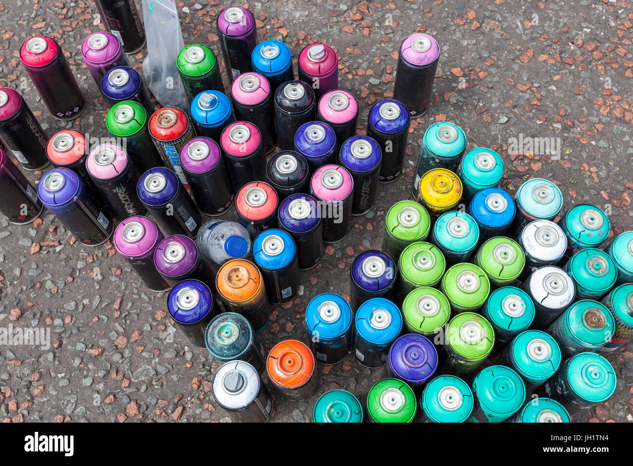 Hardcore aerosol spray paint cans - Stock Image