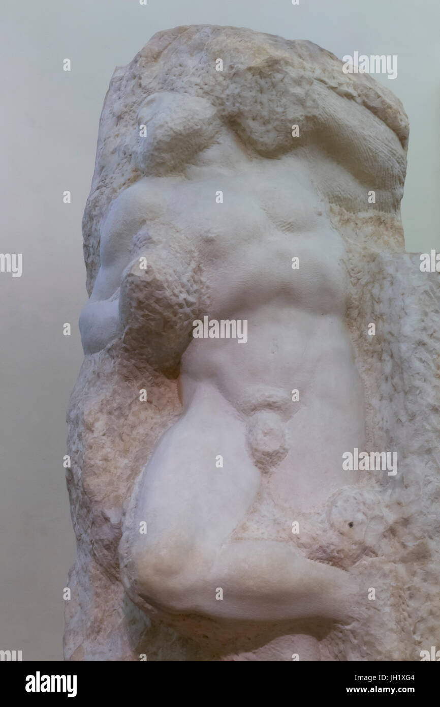 Marble Sculpture of the Awakening Slave, by Michelangelo, Accademia Gallery, Florence, Tuscany, Italy, Europe - Stock Image