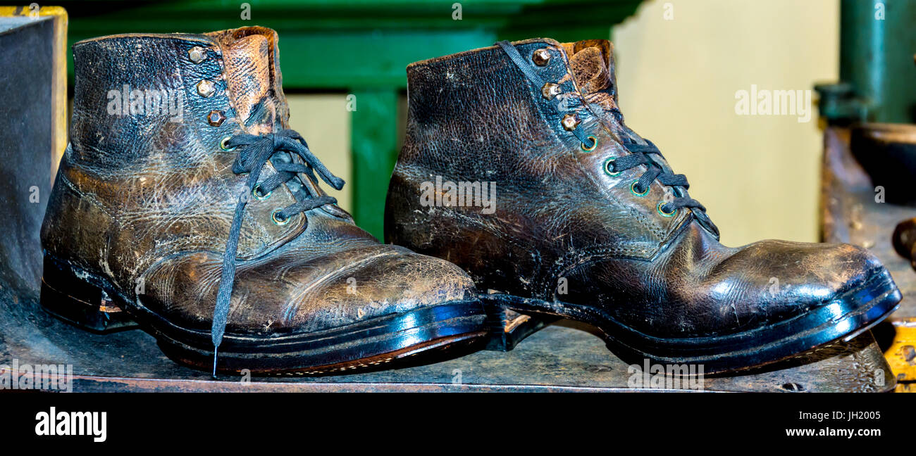 old worn out leather ankle boots - Stock Image
