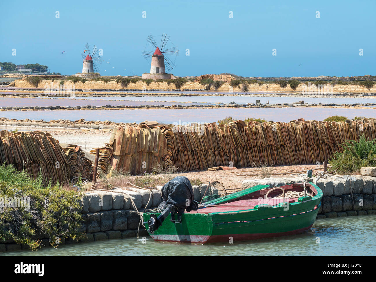 Saltpans and windmills in the Stagnone lagoon between Marsala and Trapani, on the west coast of Sicily, Italy. Stock Photo