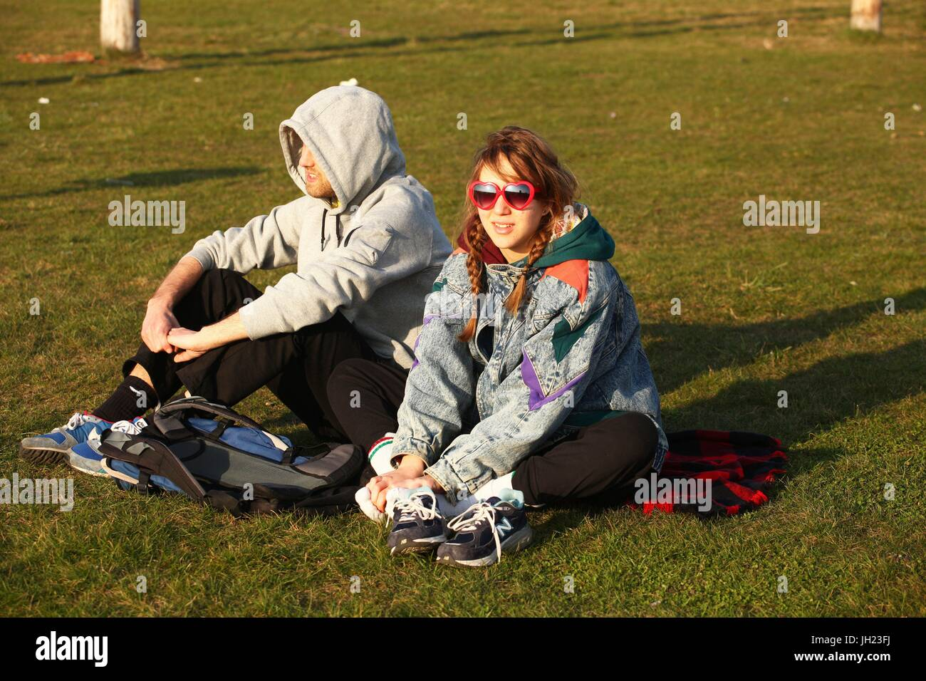 Two young German tourists are sitting on a lane at Tempelhofer Feld March 11, 2014. This picture is part of a series - Stock Image
