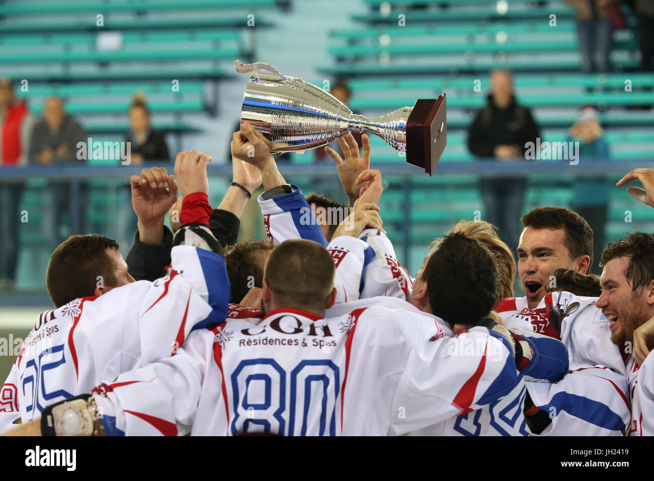 Ice Hockey match.  Hockey team with cup.  France. - Stock Image