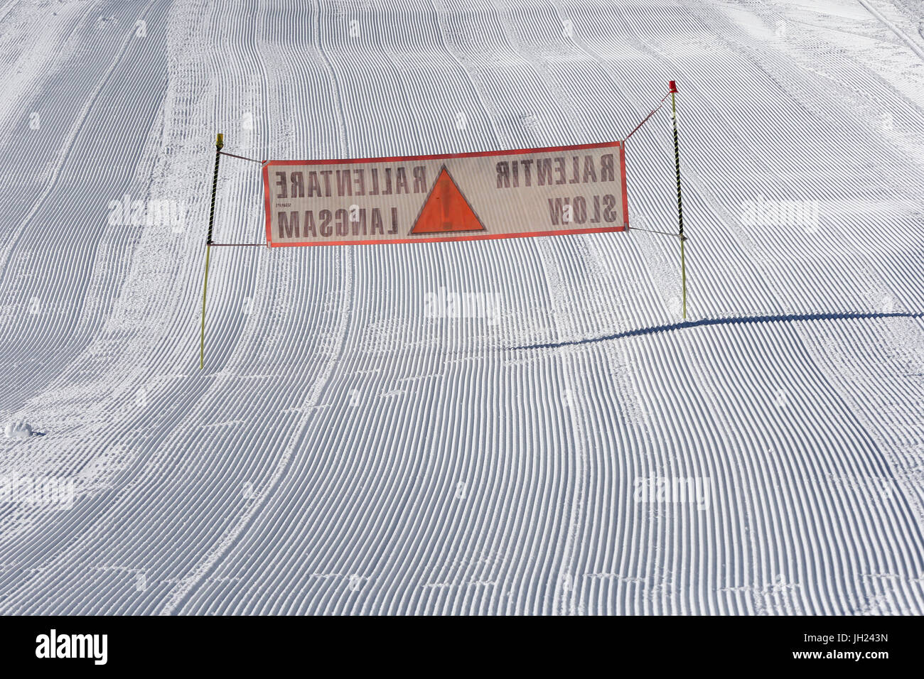 French Alps. Skiers slow sign. Groomed Ski Piste. France. - Stock Image