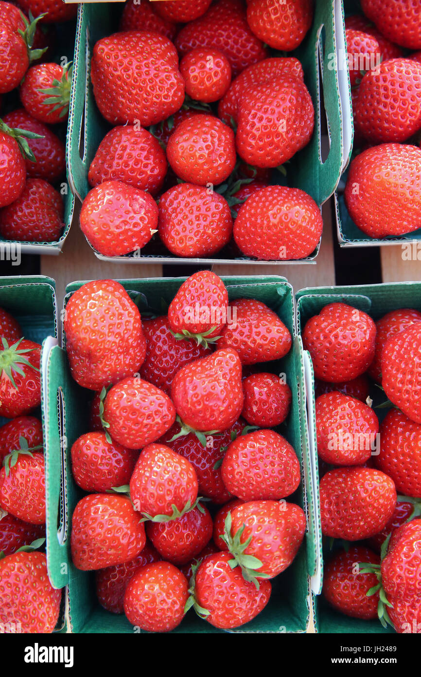 Fresh stawberries on a street market.  France. Stock Photo