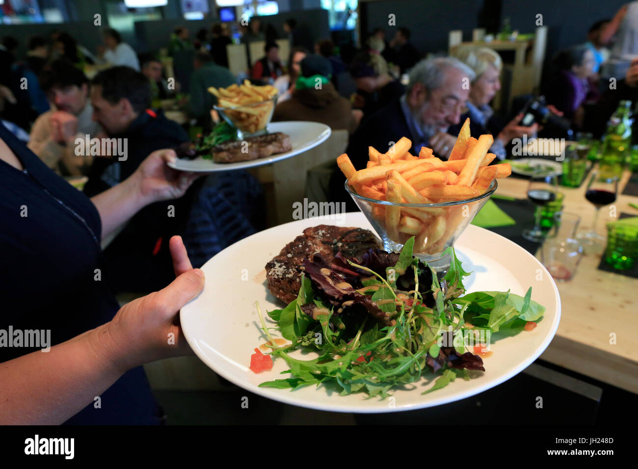 Restaurant. Steak and french fries. France. - Stock Image