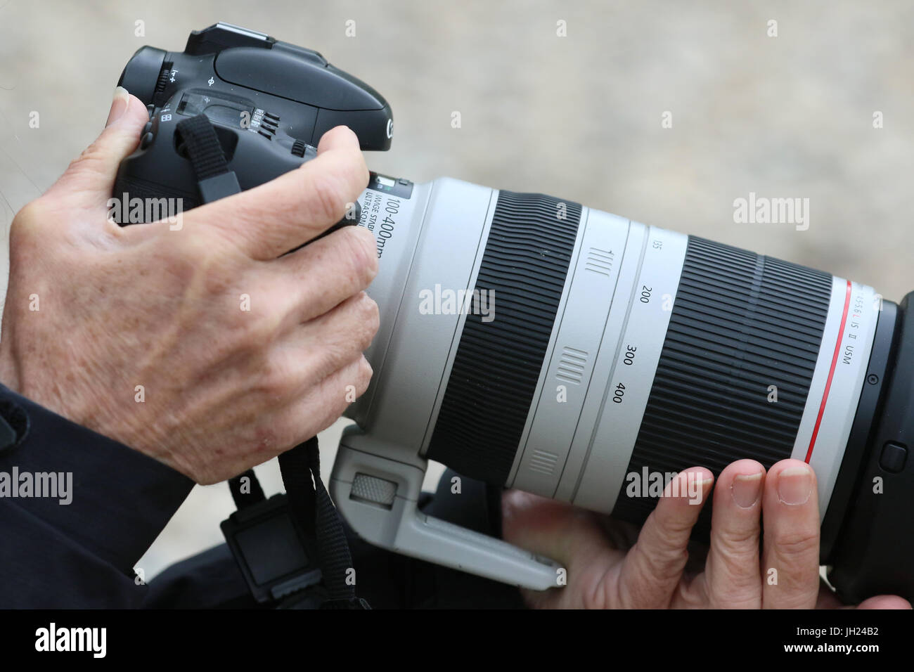 Photographer and his digital camera. - Stock Image