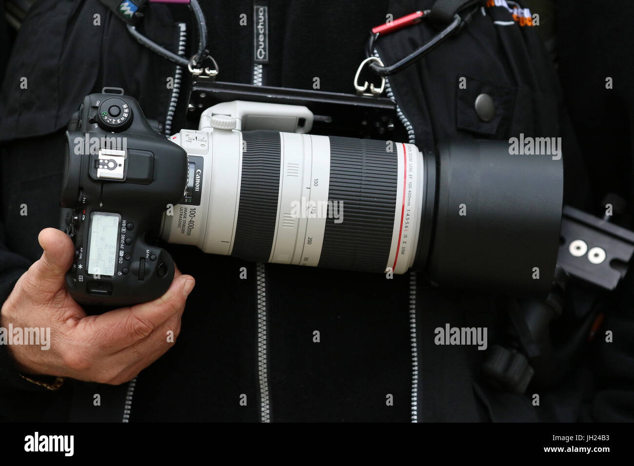 Photographer and his camera. Stock Photo