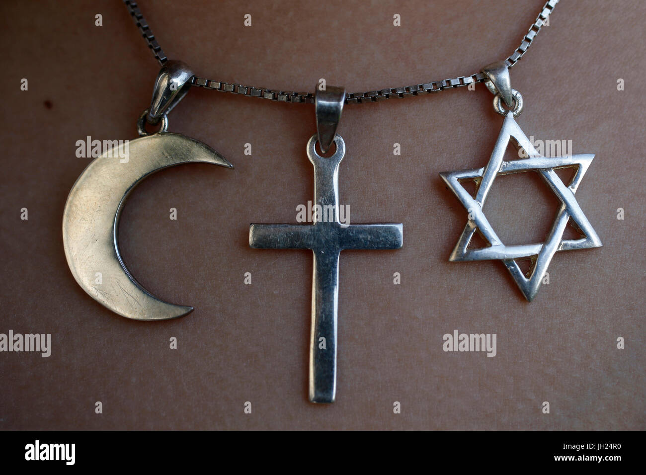 Symbols of islam, christianity and judaism. - Stock Image