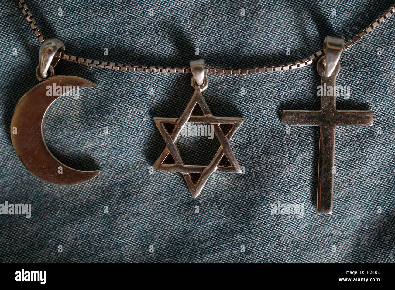 Symbols of islam, judaism and christianity. Stock Photo
