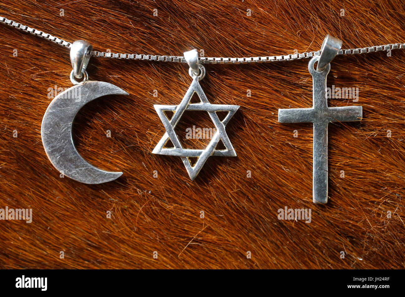 Symbols of islam, judaism and christianity. - Stock Image