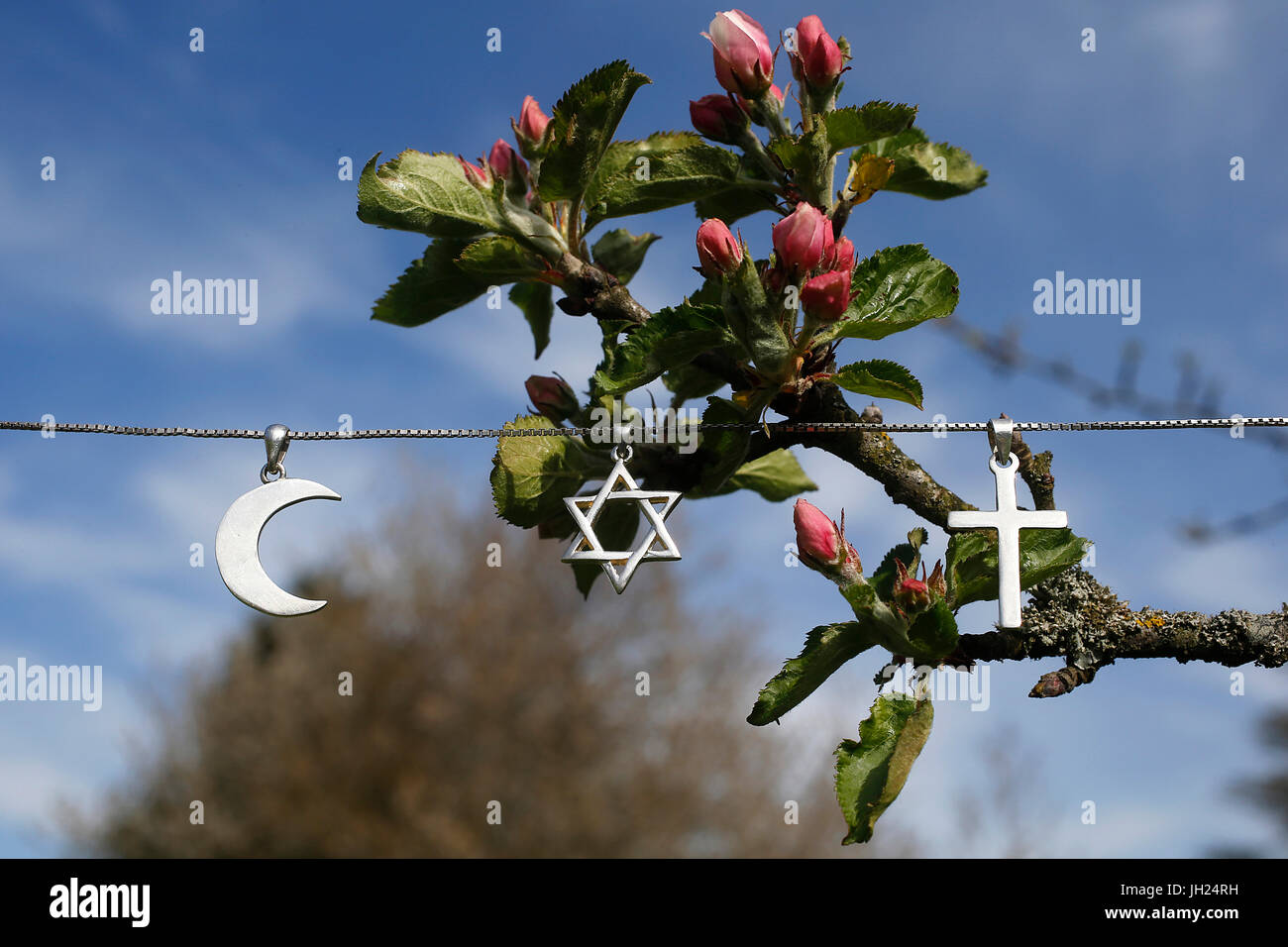 Symbols of islam, judaism and christianity. - Stock Image