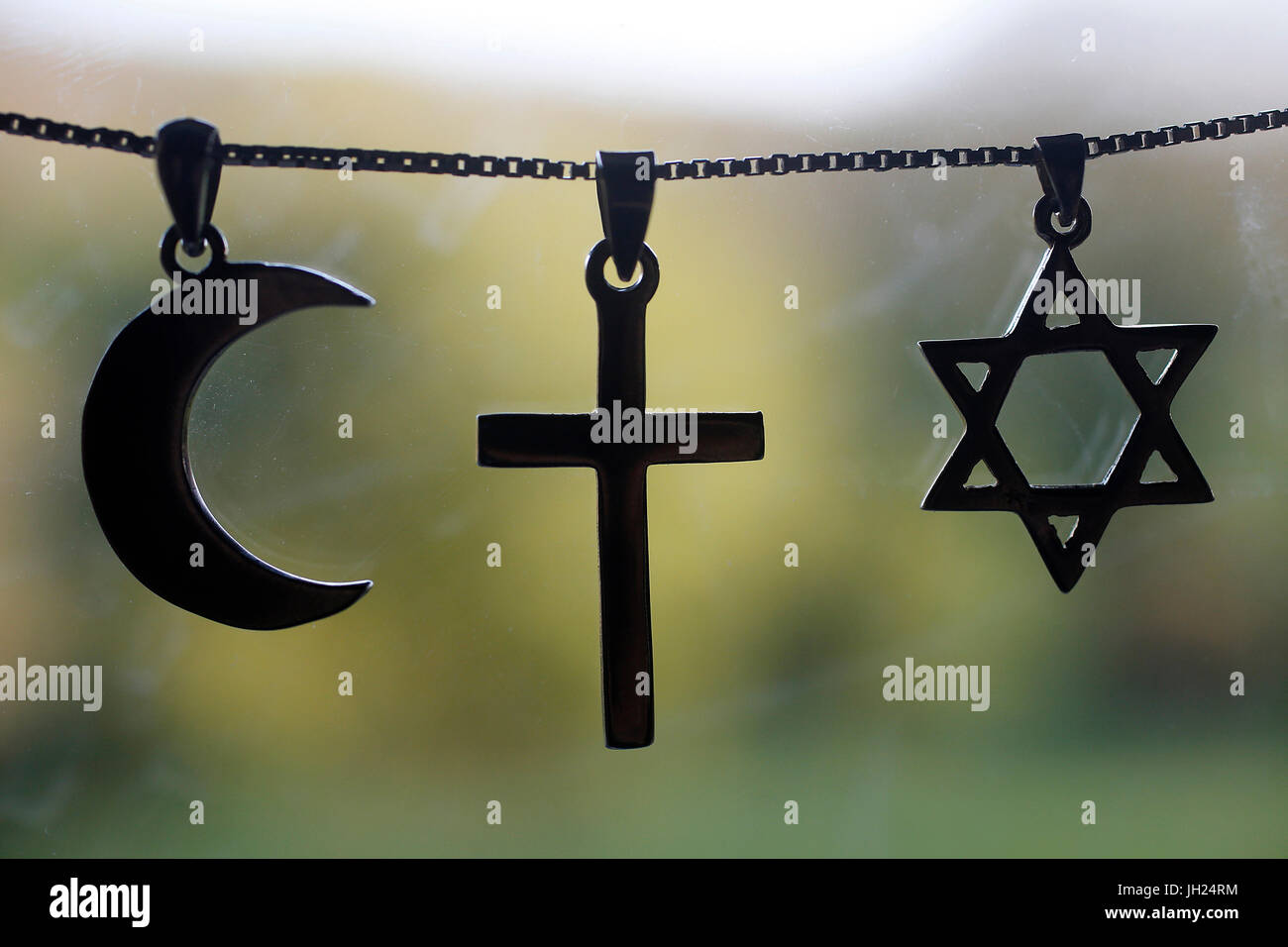 Symbols of islam, christianity and judaism. Stock Photo
