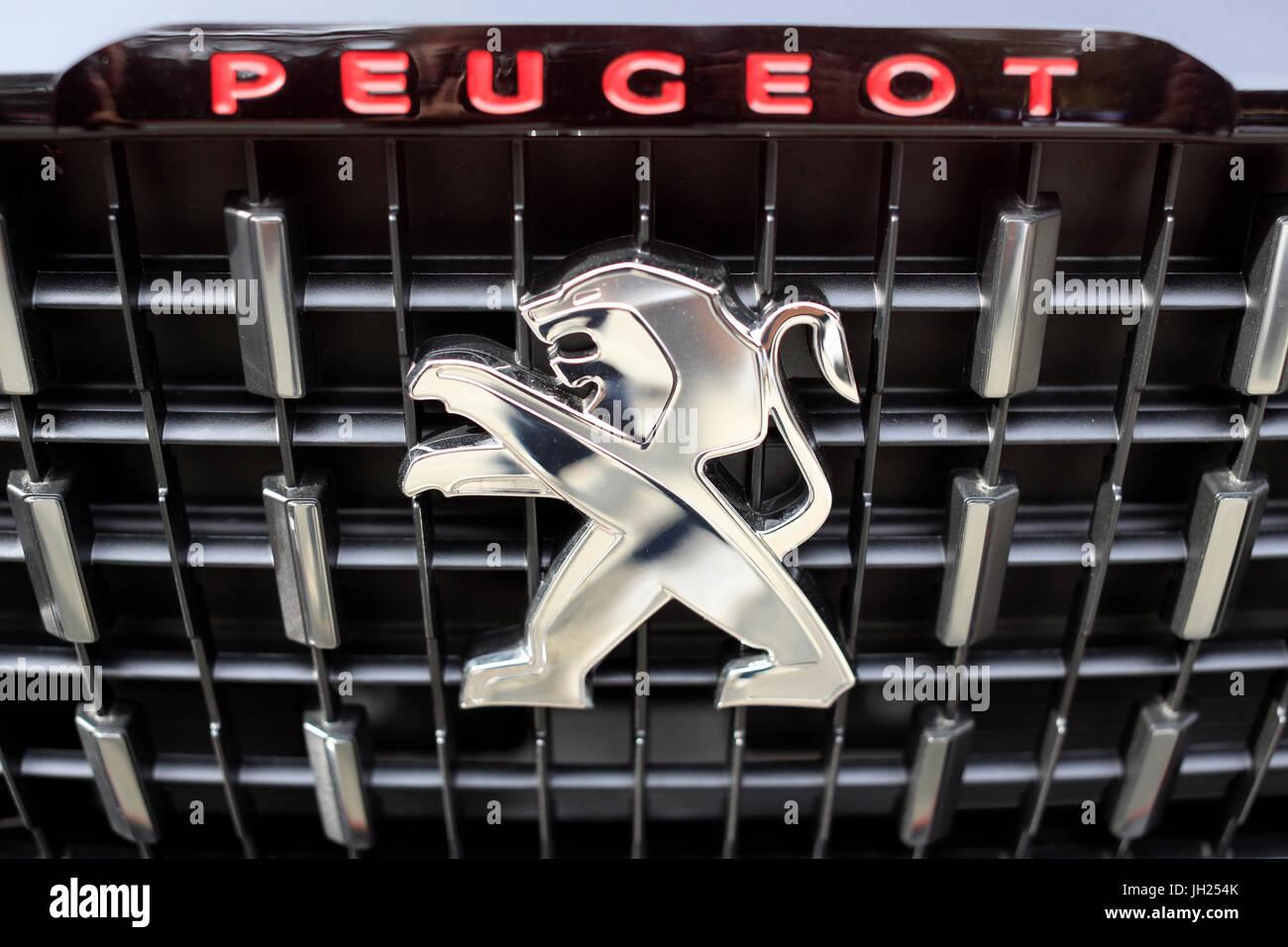 Lion on a Peugeot car. France. - Stock Image